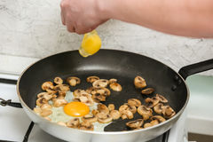 Fried eggs with mushrooms for a breakfast Stock Images