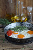 Fried eggs in an old pan Stock Photography
