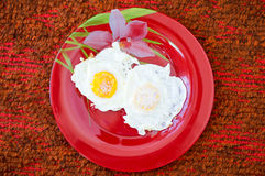 Fried eggs, omelet on a red plate Royalty Free Stock Photography