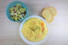 Fried eggs omelette with melted cheese and a salad royalty free stock photos
