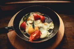 Fried eggs fried in a pan in a rustic style. antique wood window sill stand stock photography