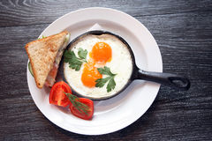 Fried Eggs On Pan Stock Photo