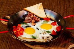 Fried eggs in the pan stock images
