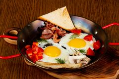 Fried eggs in the pan stock image