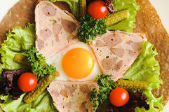 Fried eggs on pancake with vegetables. Tomato pickles parsley lettuce on and purple basil on plate. Colorful breakfast with egg and vegetables on pancake Stock Image