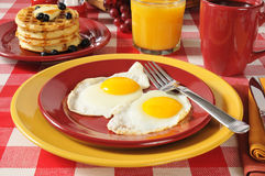 Fried eggs and pancakes Royalty Free Stock Images