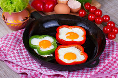 Fried eggs in peppers Royalty Free Stock Photo
