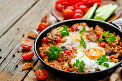 Fried eggs with peppers, tomatoes, quinoa and mushrooms Stock Image