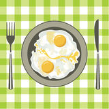 Fried eggs in a plate Stock Image