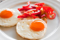 Fried eggs on  plate Royalty Free Stock Photography