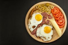 Fried Eggs on a plate. A hearty breakfast for athletes. Healthy food. Stock Images