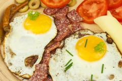 Fried Eggs on a plate. A hearty breakfast for athletes. Healthy food. Stock Photos