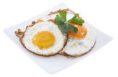 Fried Eggs on a plate (white background) Royalty Free Stock Photography