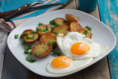 Fried eggs with potato Stock Photography