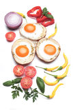 Fried eggs in potato shells Stock Photography