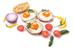 Fried eggs in potato shells Stock Image