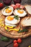 Fried eggs in potato shells Royalty Free Stock Photo