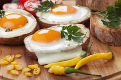 Fried eggs in potato shells Stock Images