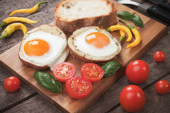 Fried eggs in potato shells Stock Photo