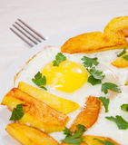 Fried eggs with potato Stock Photo