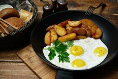 Fried eggs with potatoes stock image