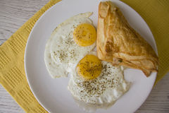 Fried eggs and puff pastry Stock Photo