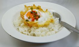Fried eggs on rice topped with chop chili fish sauce Royalty Free Stock Images
