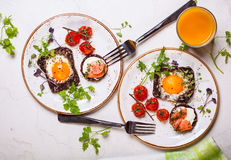 Fried eggs, salmon canape and  tomatoes Royalty Free Stock Photo