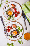 Fried eggs, salmon canape and  tomatoes Royalty Free Stock Photography