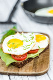 Fried Eggs on a Sandwich Royalty Free Stock Images
