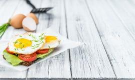Fried Eggs on a Sandwich Stock Photos