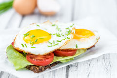 Fried Eggs on a Sandwich Stock Images