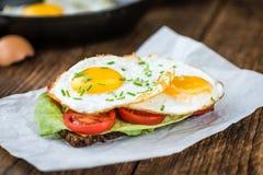 Fried Eggs on a Sandwich Stock Photo