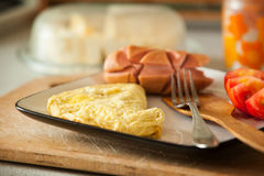 Fried eggs with sausage and fresh tomato Royalty Free Stock Photography