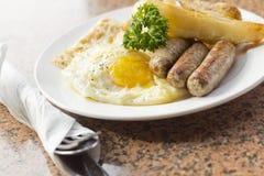 Fried Eggs Sausage Home Fries royaltyfria foton