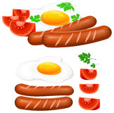 Fried eggs, sausage and tomato Royalty Free Stock Photography