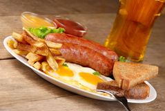 Fried eggs with sausages Stock Image