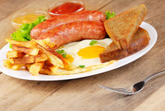 Fried eggs with sausages Royalty Free Stock Images
