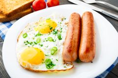 Fried eggs with sausages. Royalty Free Stock Photography