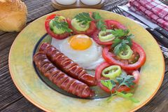 Fried eggs and sausages in plate on  table Stock Photography