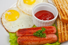 Fried eggs with sausages Stock Photography