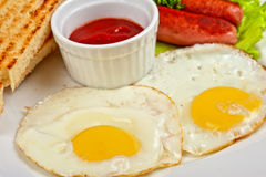 Fried eggs with sausages Royalty Free Stock Photo