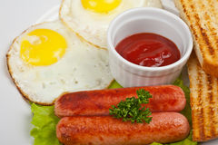 Fried eggs with sausages Stock Photo