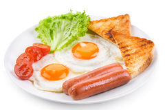 Fried eggs with sausages, tomatoes and toasts Royalty Free Stock Photography