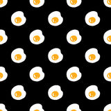 Fried eggs seamless pattern on black Royalty Free Stock Image