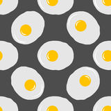 Fried eggs seamless pattern on grey background.  Royalty Free Stock Photo