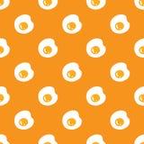 Fried eggs seamless pattern on orange Stock Photo