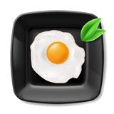 Fried eggs served on black plate Royalty Free Stock Photo