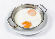Fried eggs on the skillet Royalty Free Stock Image