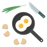 Fried eggs on skillet Stock Images